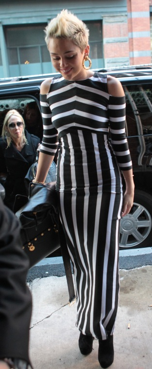 Miley Cyrus arrives in stripes