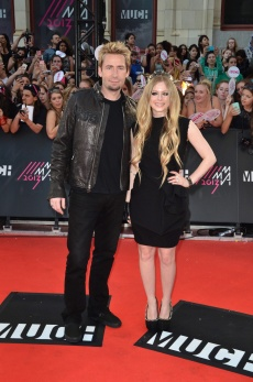 Chad Kroeger and Avril Lavigne arrive at the 2013 MuchMusic Video Awards at MuchMusic HQ in Toronto