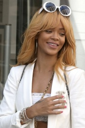 June - caramel blonde hair with a full fringe
