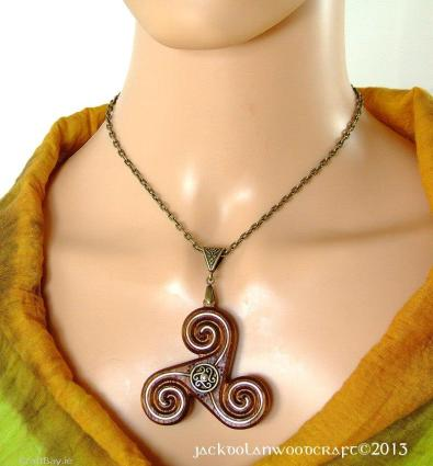 Celtic Triskele Pendant In Iroko Hardwood €25 http://craftbay.ie/Product/640/Jewellery/Necklace/Celtic-Triskele-Pendant-in-Iroko-hardwood