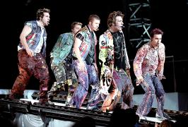 2001 - Performing 'Pop' with *NSYNC in camoflauge/newsprint/cut out rags..