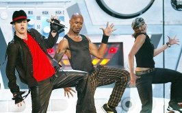 2002 - Justin performs at the Video Music Awards, donning baggy faux leather pants and his signature fedora hat