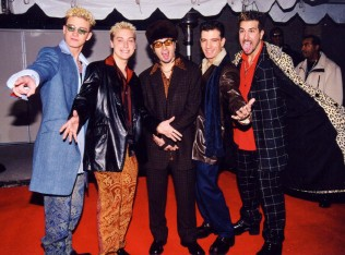 1998 - *NSYNC wearing clash-upon-clash patterned suits