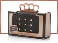 Rogue knuckle-holder box clutch with, by Rihanna