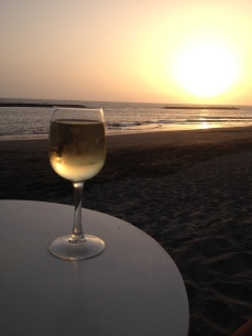 Wine on the beach at sunset