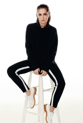 Cheryl wears sweater by Margaret Howell, trousers by Prabal Gurung, shoes by Trickers,