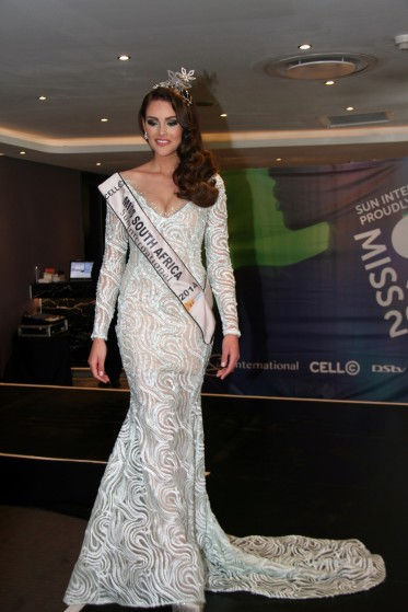 Miss South Africa, Rolene Strauss, wearing her evening gown designed by Casper Bosman