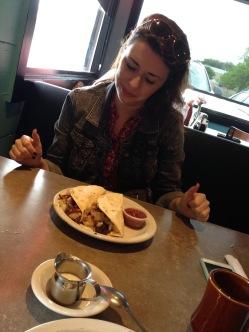 Magnolia Café - Chloe admiring her beloved Breakfast Tacos