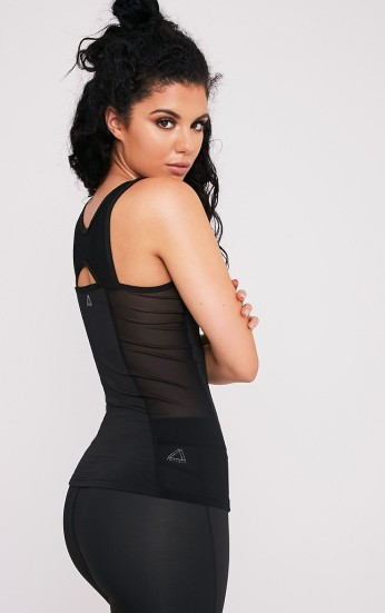 Pretty Little Thing Keelie Black Mesh Insert Gym Top, €21 https://ie.prettylittlething.com/keelie-black-mesh-insert-gym-top.html