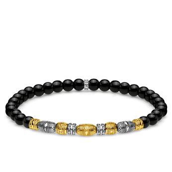 Thomas Sabo Two Tone Lucky Charm Bracelet in Black & Gold, €149 http://bit.ly/2sSaOII