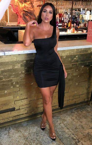 Femme Luxe Alise Black Slinky One Shoulder Tie Side Dress, €36.95 https://femmeluxefinery.co.uk/products/black-slinky-one-shoulder-tie-side-dress-alise