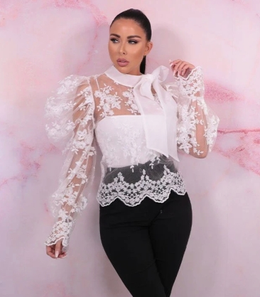 Femme Luxe Lola White Lace Puff Sleeves High Neck Top, €47.95 https://femmeluxefinery.co.uk/products/white-lace-puff-sleeves-high-neck-top-lola
