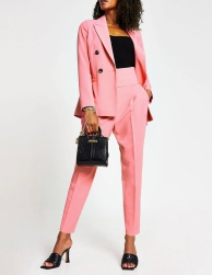 River Island Pink Suit: Pink Double Breasted Blazer, €87 https://bit.ly/3kWQ9cf Pink High Waist Tapered Trousers, €51 https://bit.ly/2GocRL8